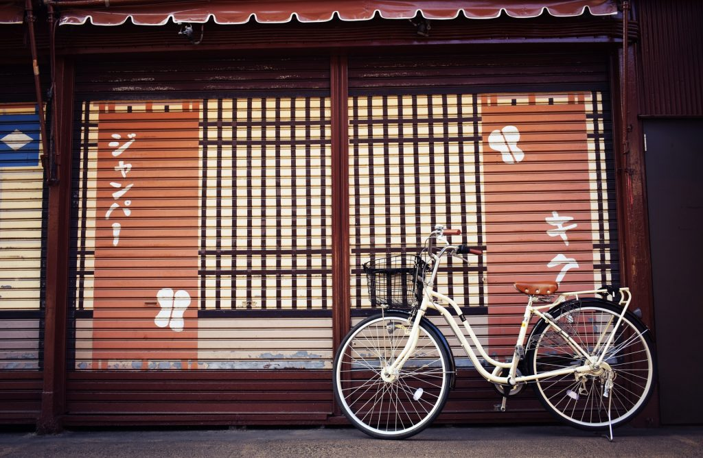 a bike infornt of a closed store