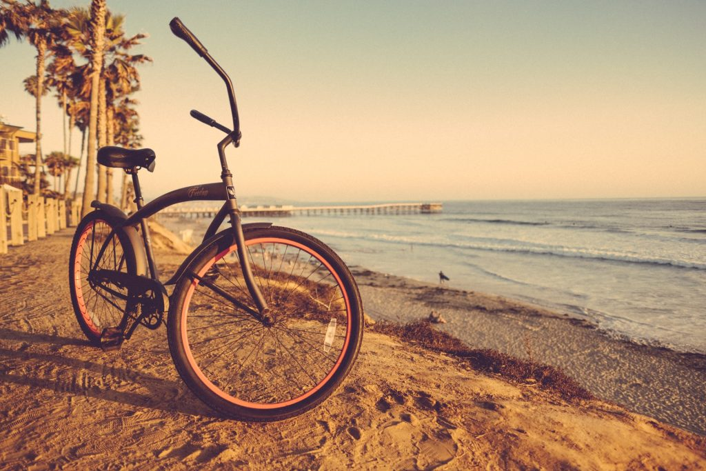 a bike on the beach with sea background