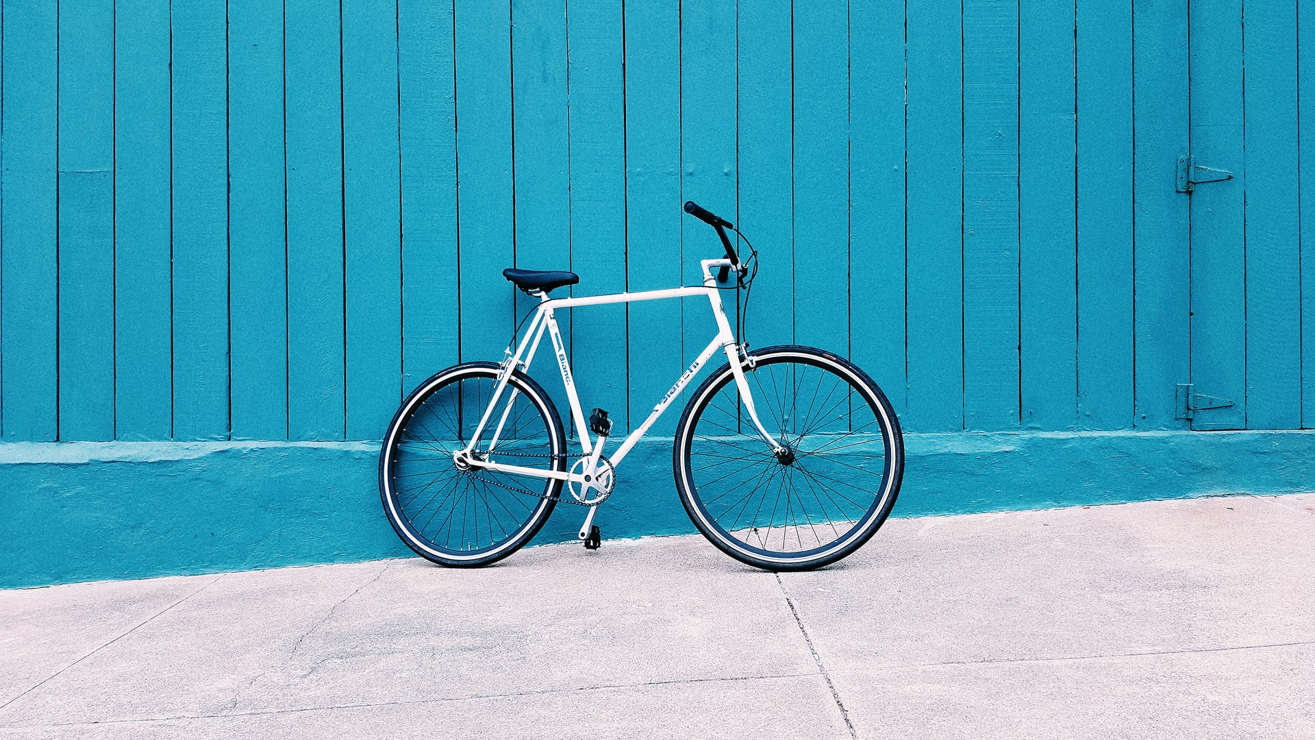 blue background with white bike