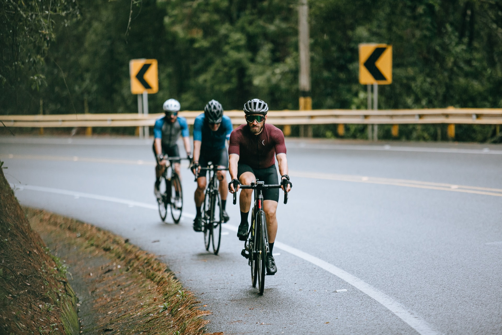 Men Riding Bicycle on the road